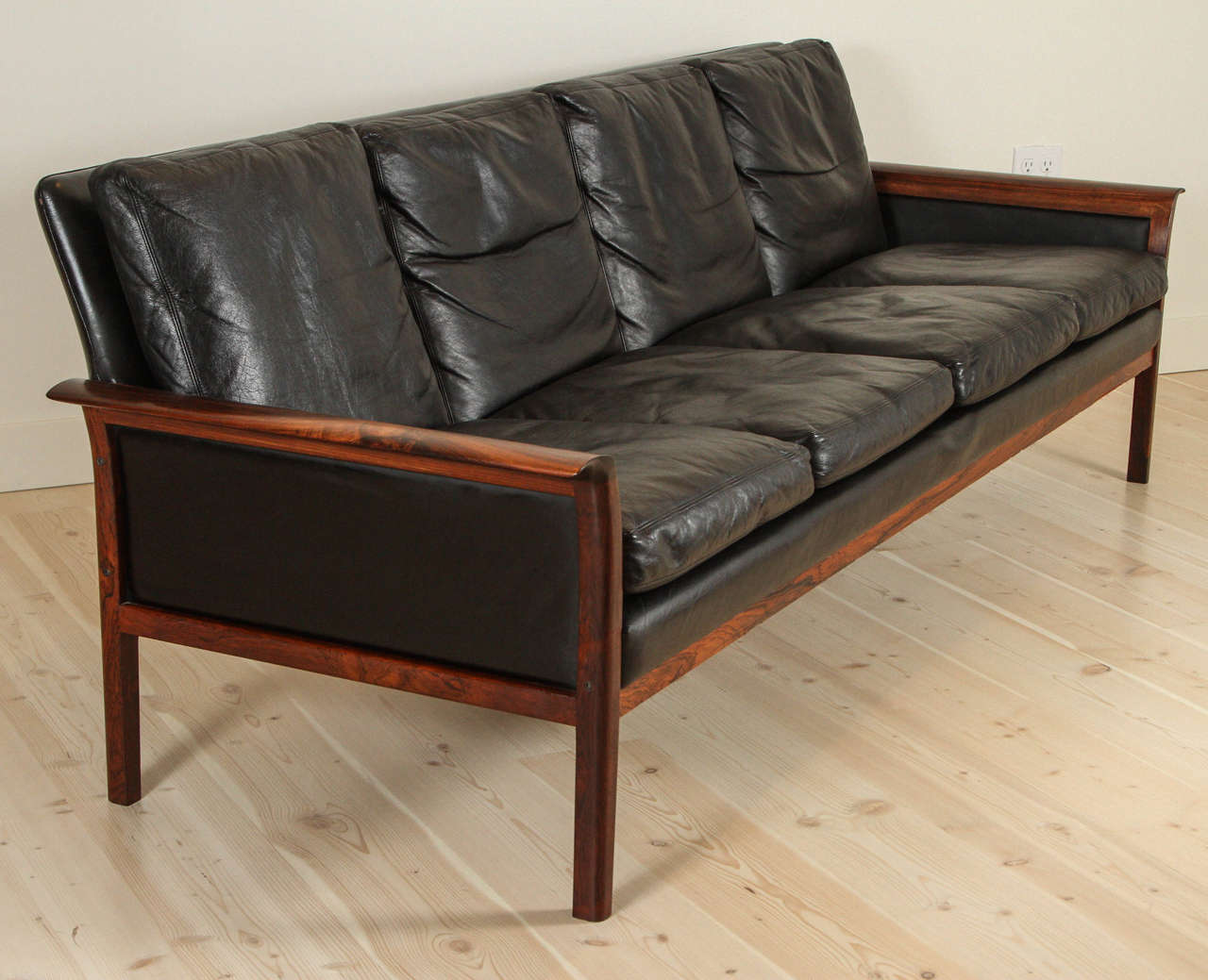 Leather and rosewood sofa by Hans Olsen.