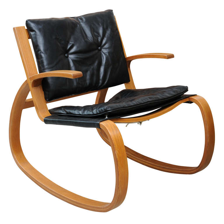 mid century modern rocking chair with black leather top