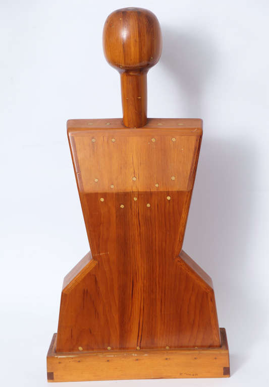 A female torso wood sculpture signed Mike Nevelson, 1961.