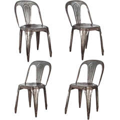 Set of Four Metal Stacking Chairs by Tolix