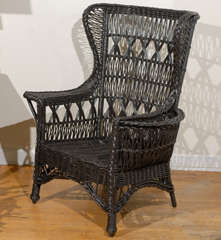 Antique American Wicker Wing Chair with Magazine Pocket image 2