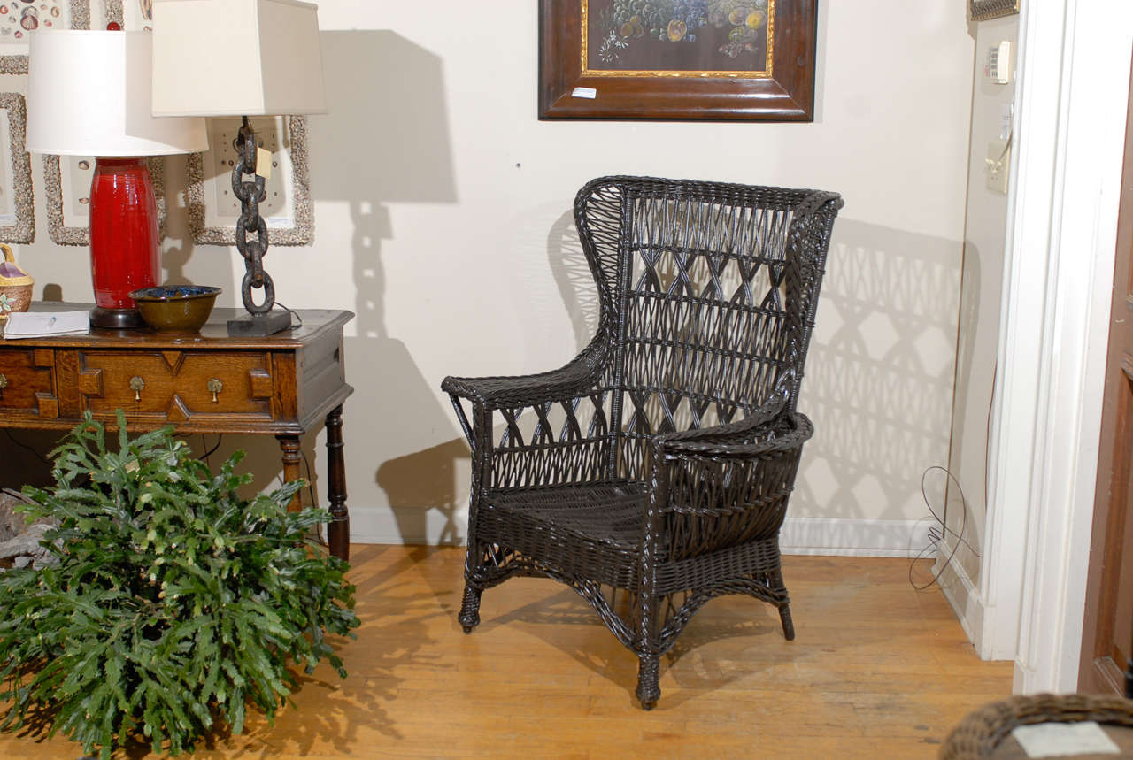 Art Deco Antique American Wicker Wing Chair with Magazine Pocket For Sale