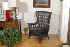 Antique American Wicker Wing Chair with Magazine Pocket image 3