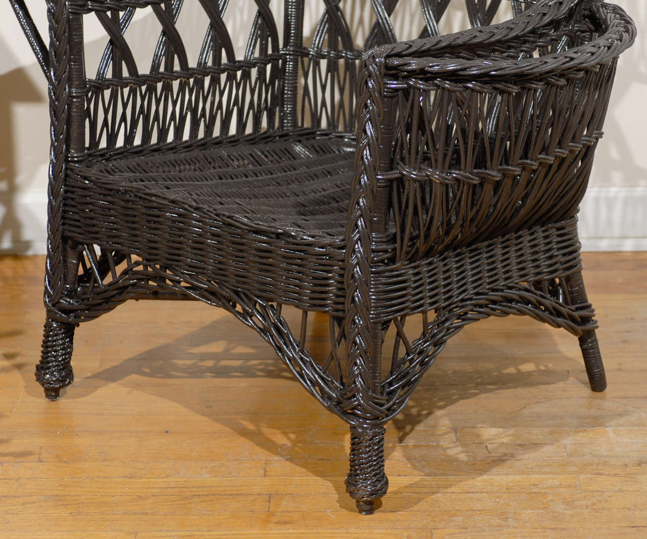 Antique American Wicker Wing Chair with Magazine Pocket In Excellent Condition For Sale In Atlanta, GA
