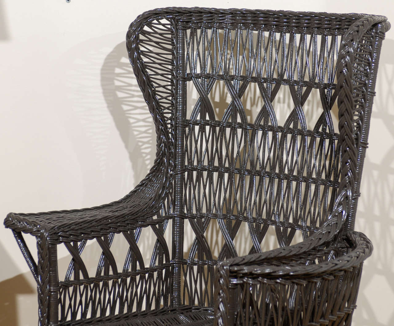 20th Century Antique American Wicker Wing Chair with Magazine Pocket For Sale