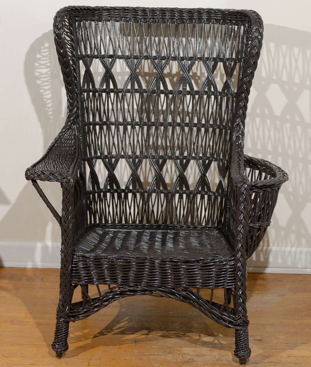 Antique American Wicker Wing Chair with Magazine Pocket at