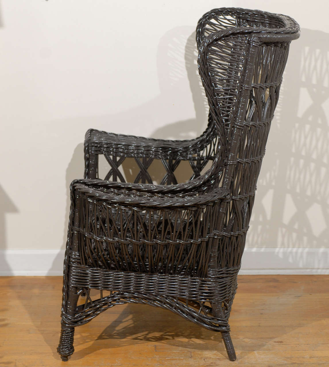 Antique American Wicker Wing Chair with Magazine Pocket For Sale 2