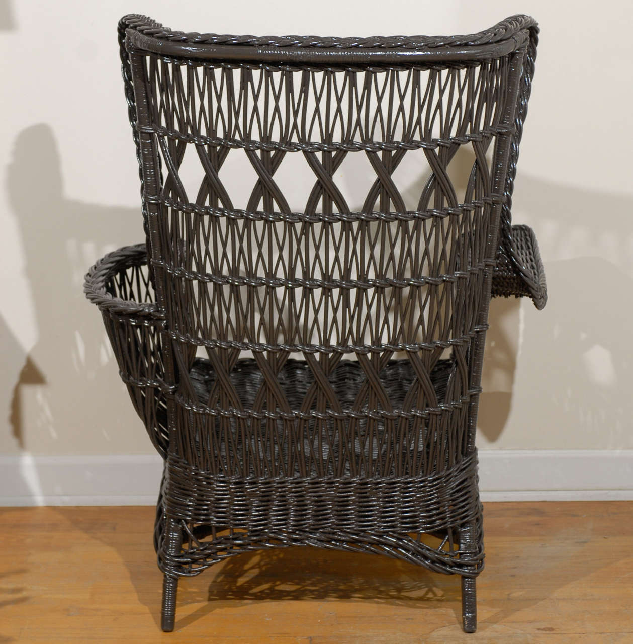 Antique American Wicker Wing Chair with Magazine Pocket For Sale 3