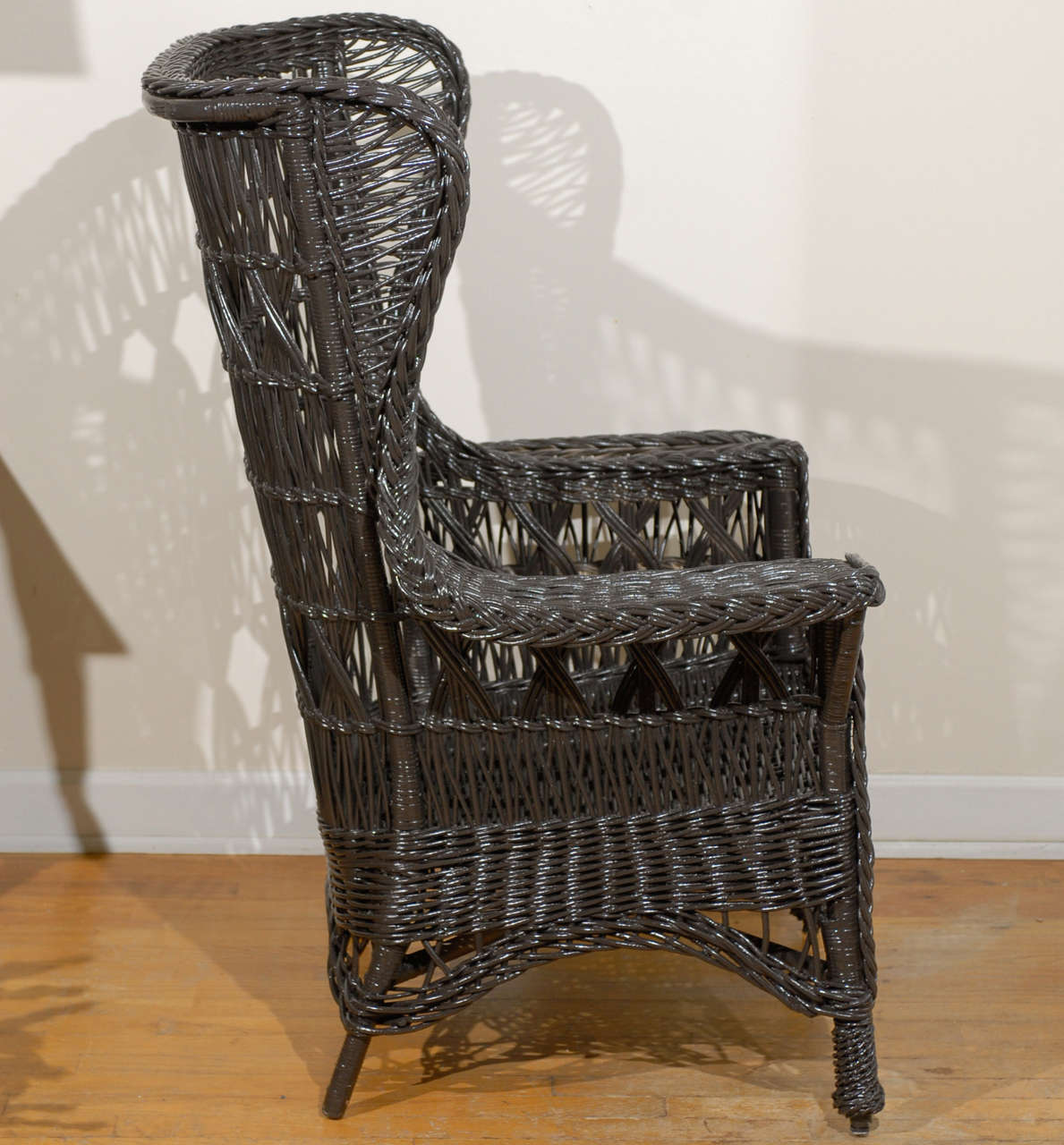 Antique American Wicker Wing Chair with Magazine Pocket For Sale 4