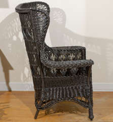 Antique American Wicker Wing Chair with Magazine Pocket image 9