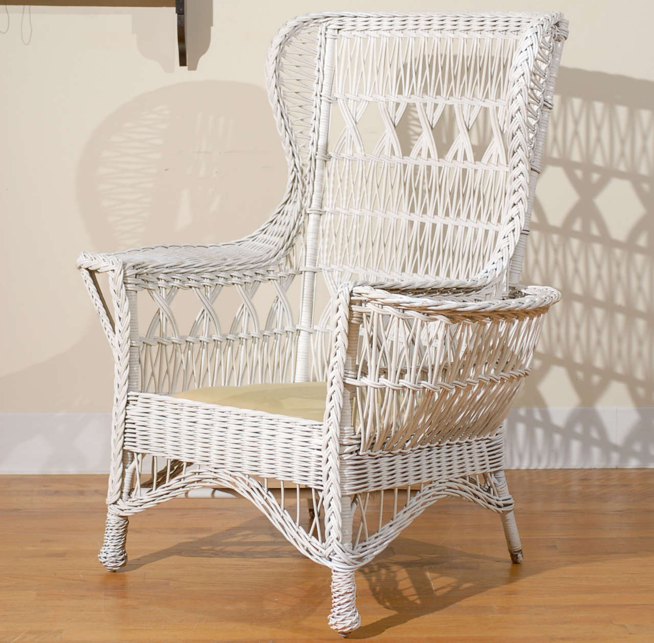 This is a beautiful white antique American wicker wing chair in the Mission  style with magazine - Antique American Wicker Wing Chair With Magazine Pocket At 1stdibs