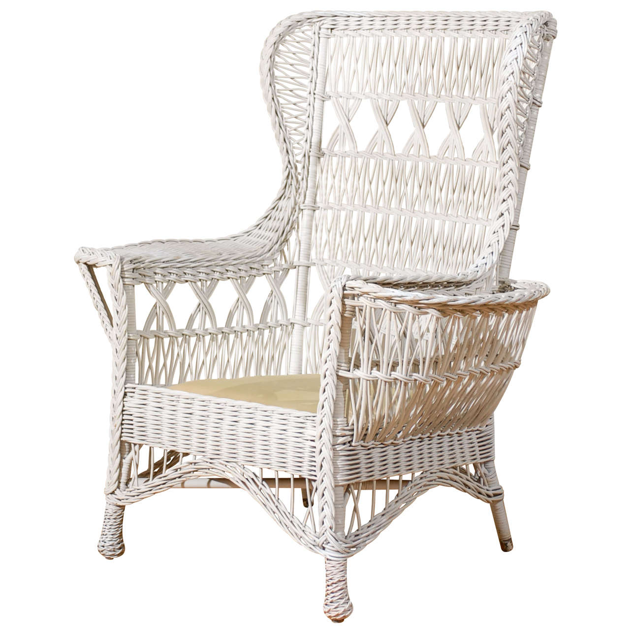 Charming Antique American Wicker Wing Chair With Magazine Pocket For Sale