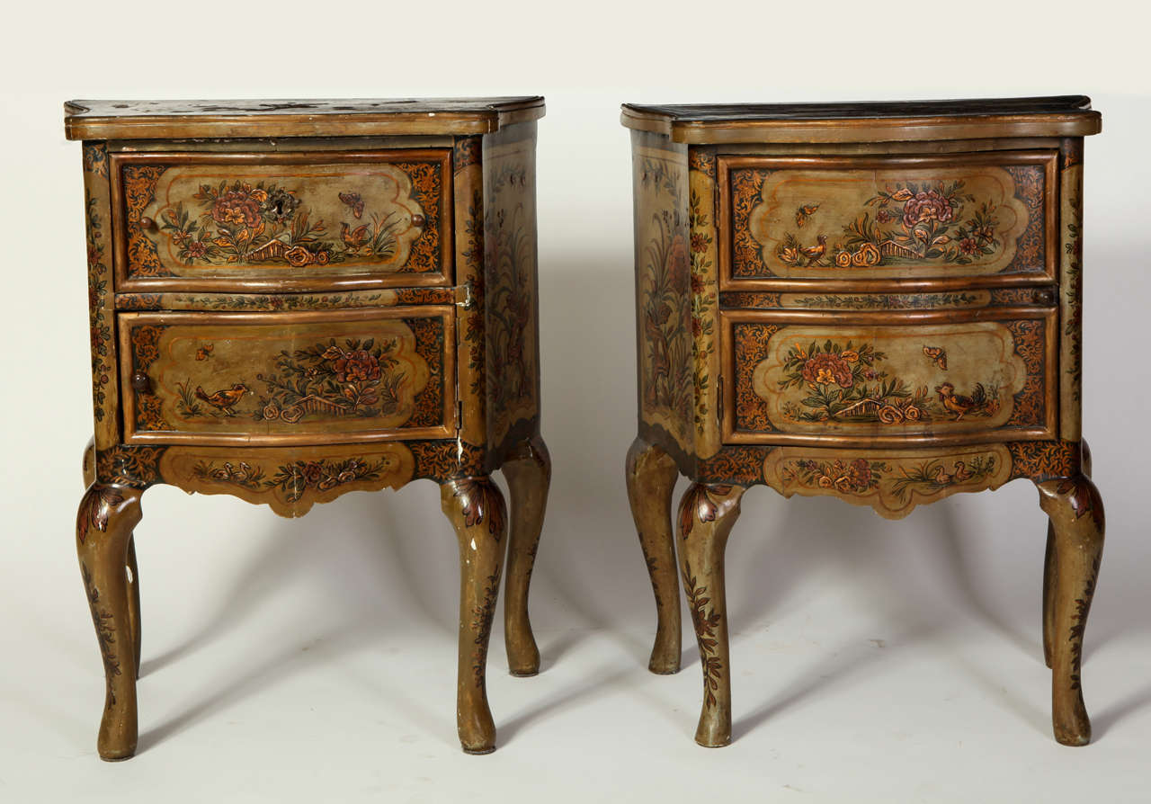 A pair of small Italian pale green lacquered, parcel-gilt and pastiglia decorated commodes.