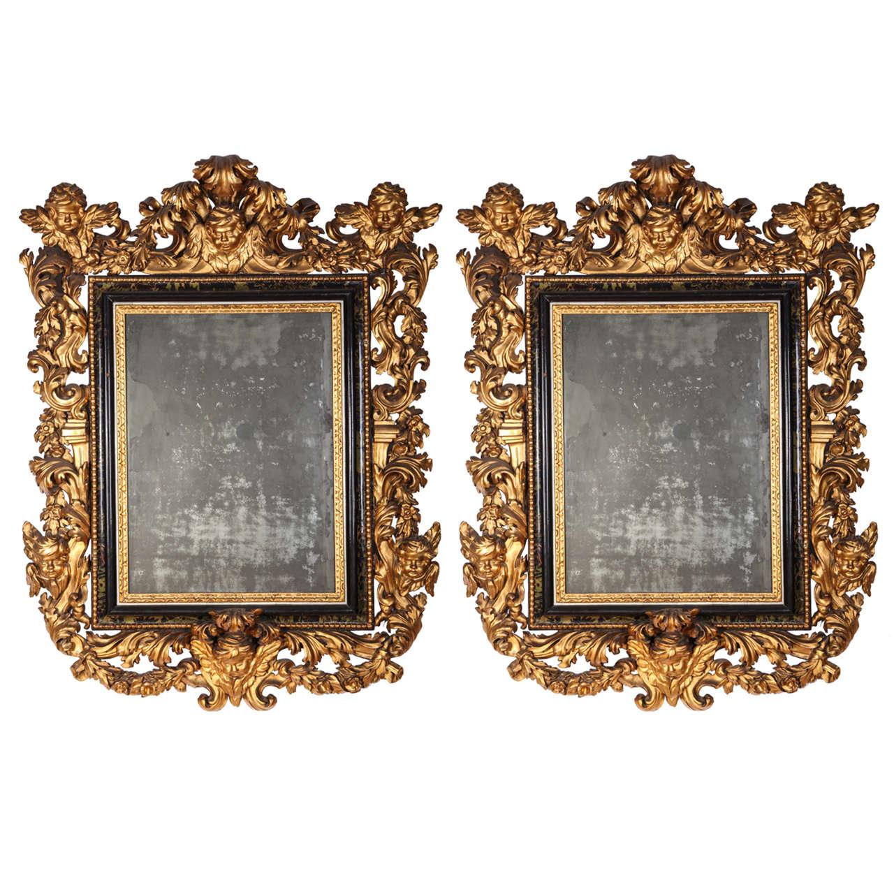 Stunning Pair of Carved Italian Giltwood Mirrors 17' century