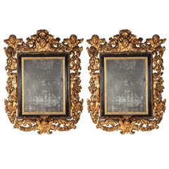 Stunning Pair of Carved Italian Giltwood Mirrors 17' century