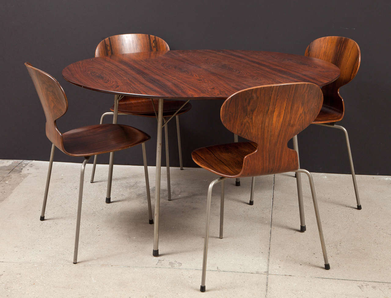 A Matching Set Of Four Dining Chairs And Round Table In Rosewood With Steel Lets