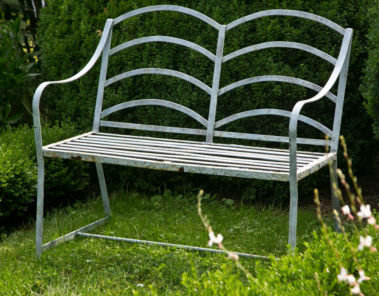 A small wrought-iron Regency-style seat.