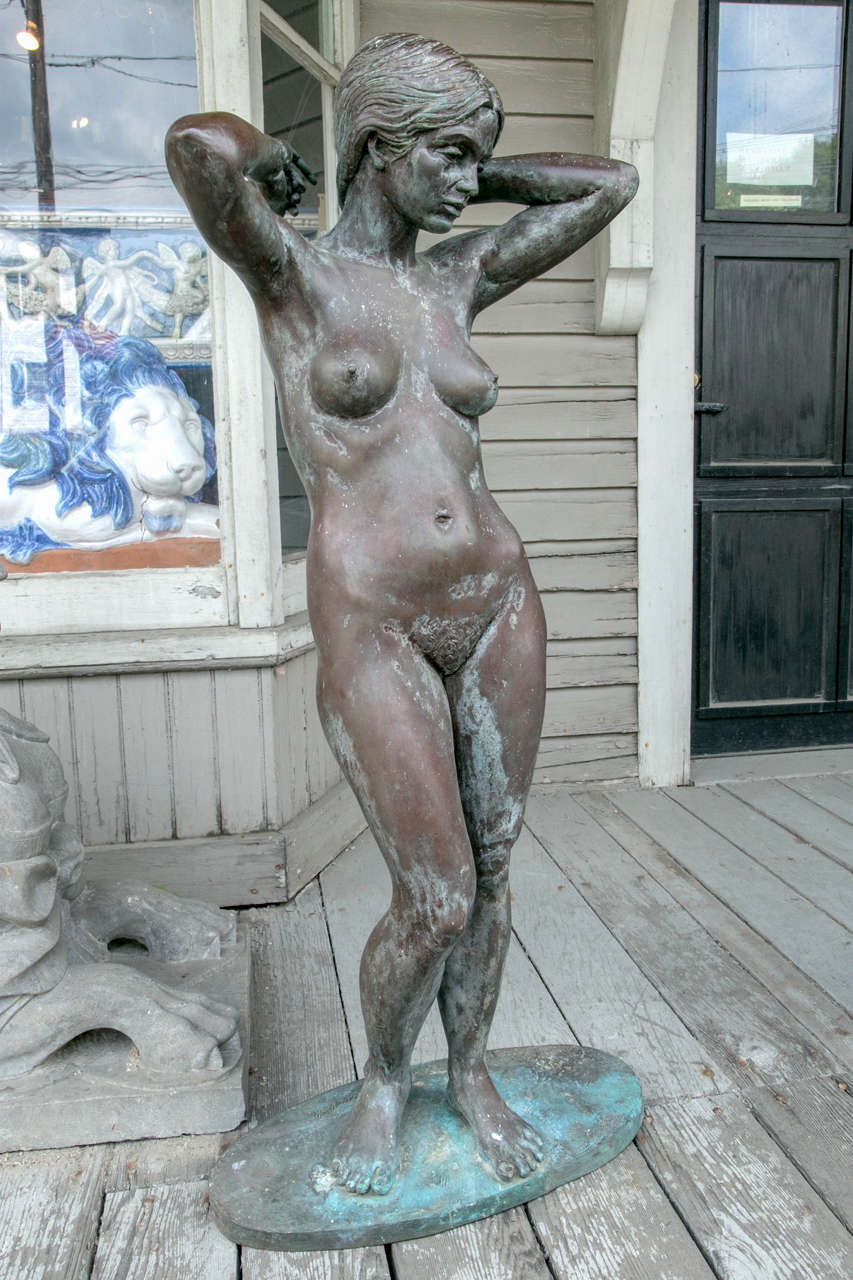 A full figured bronze of a female nude, signed on the base Eric Parks (born 1948). Weathered patina.