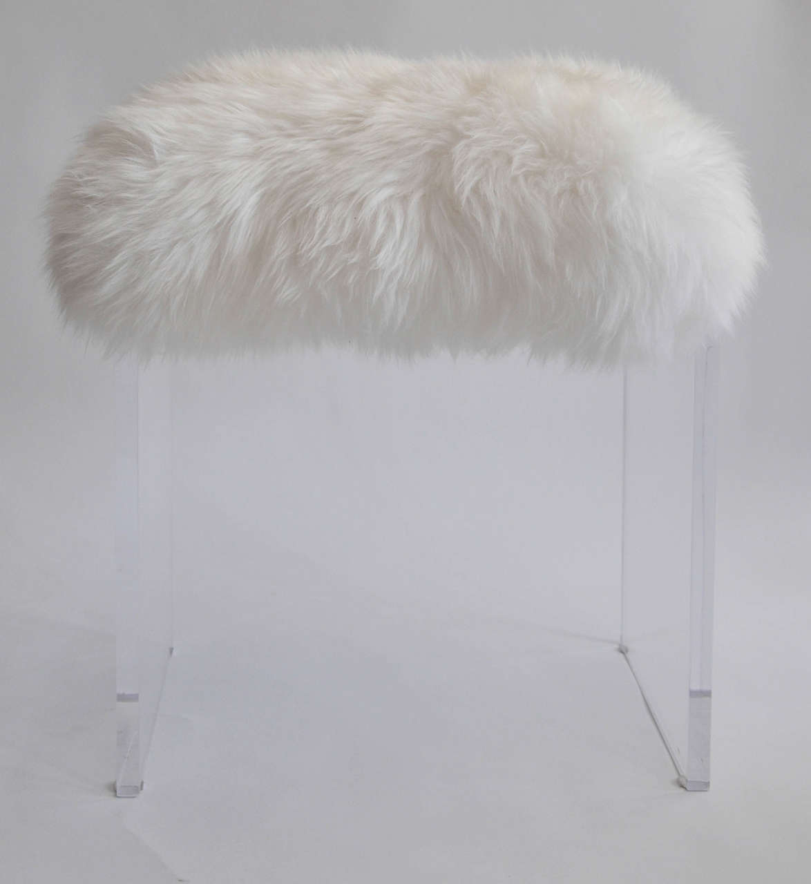 this vintage lucite stool with faux fur topper is no longer available