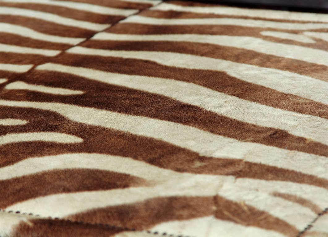 custom coffee/cocktail table upholstered in vintage zebra hide 1