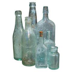 Group of 7 Aqua Bottles
