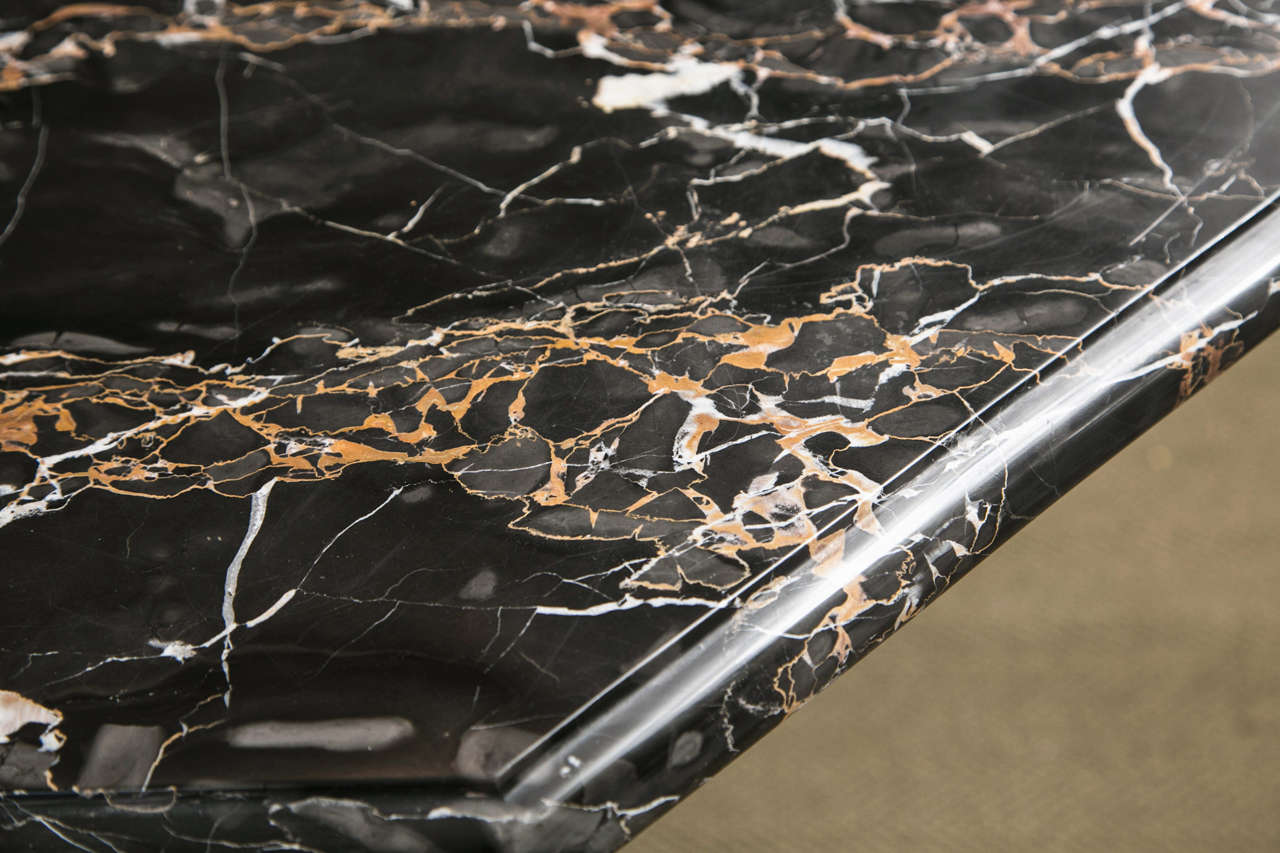 Gilded bronze base with black gold veined marble top table