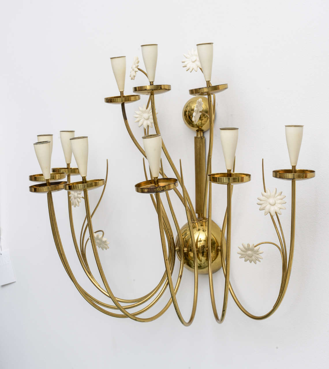 Our over-sized 50's Italian candle sconce delights the eye with delicately curving brass arms and whimsical white painted flowers... and did we mention its impressive scale? So charming with all 10 candles lit over a small sideboard or soaking tub!