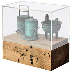 Collection of 20th Century Chinese Bronze Miniatures in a Weathered Wood/Acrylic