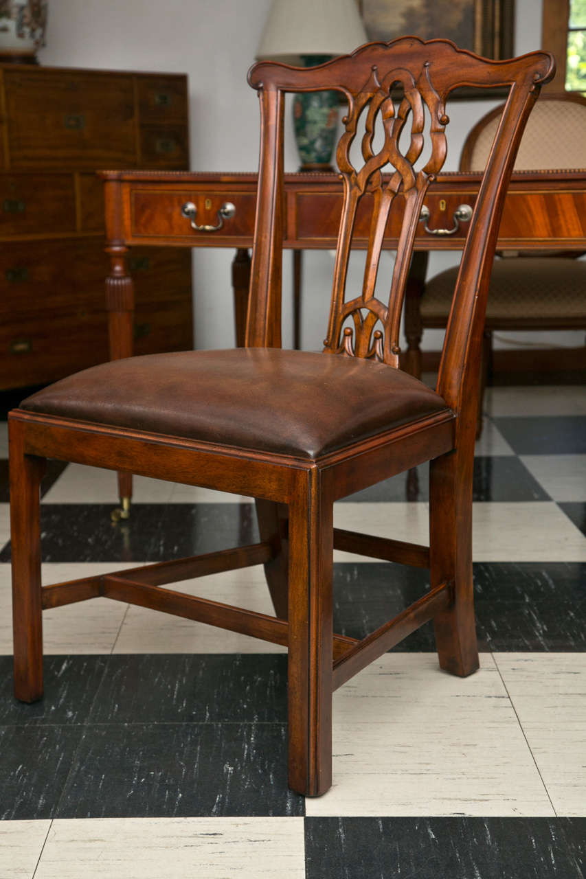 Classic George III style carving defines these dining chairs. Lyrically executed, the lines traverse the back while providing comfortable support in a chair that on first inspection looks as though it may have placed form over function. Add the