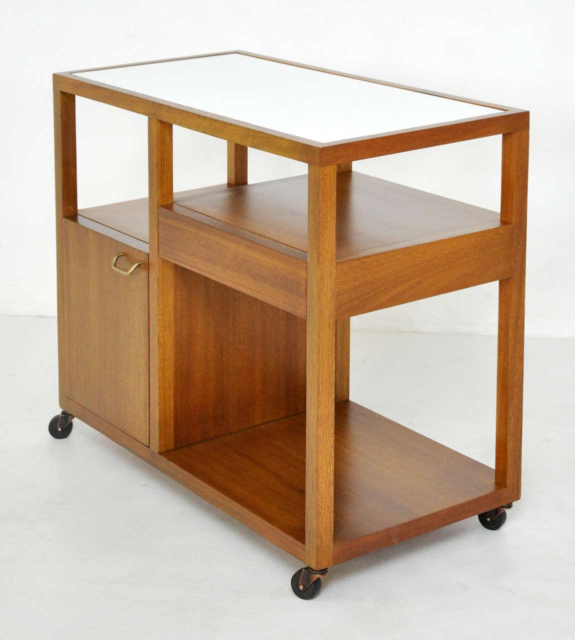 Server trolley designed by Harvey Probber. Fully restored mahogany case with white vitrolite glass top.