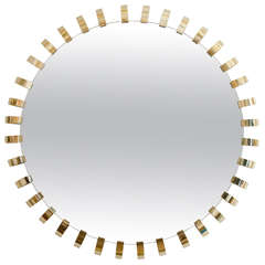 Monumental mirror with brass loop surround