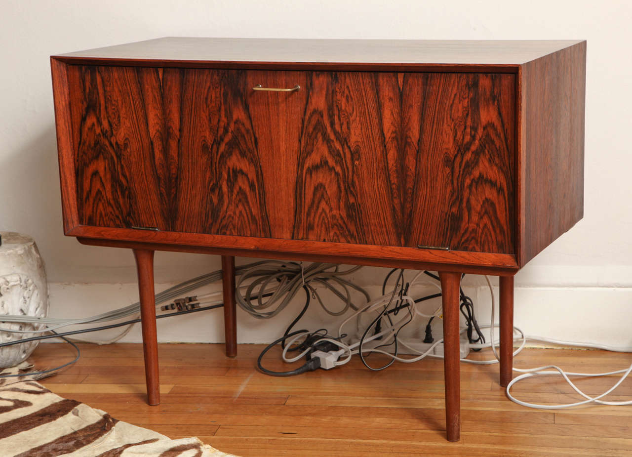 Mid century Italian wood cabinet with fold-down door. Perfect for bar or media cabinet. Cabinet interior is 13.8