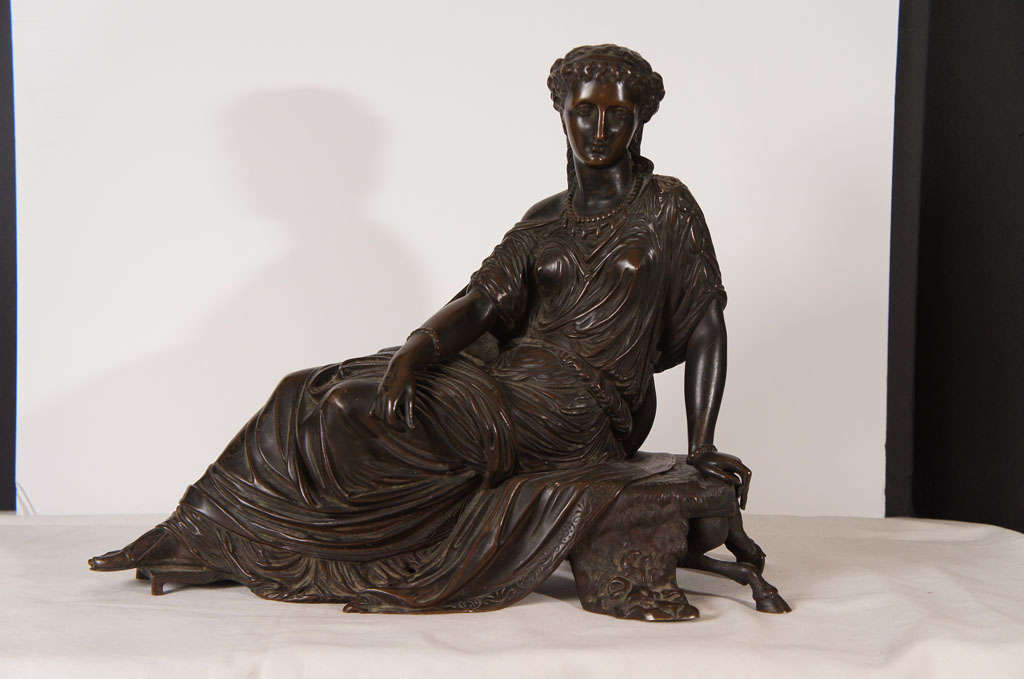 This finely cast bronze shows great attention to detail. The seated figure is cast in a number of sections giving a level of natural grace only found in the finest works. The rest of the bronze is also cast in a number of sections creating a