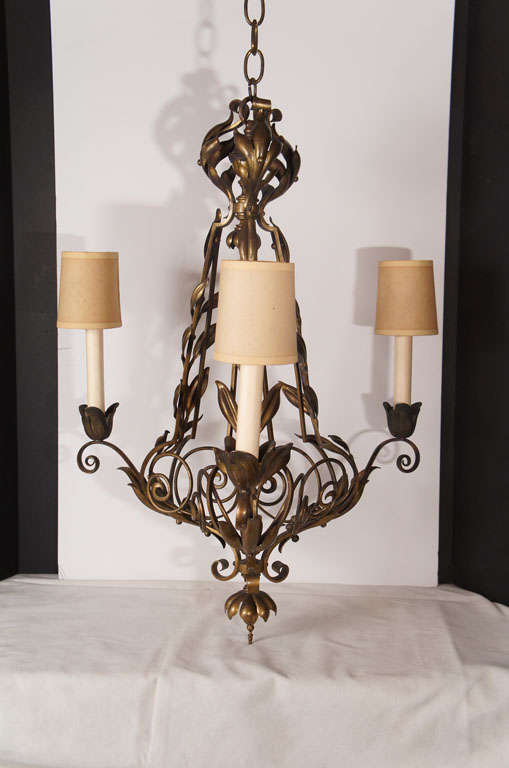 This fixture made in the early 1900s shows many aspects of the art nouveau period. Cast in sections and then screwed together the piece has great movement and lightness in the design. Cast as separate leaf sections and attached to scrolling vine