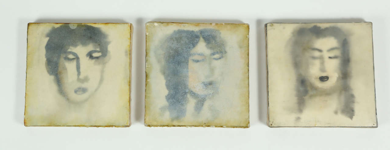 A haunting trio of encaustic portraits by Eric Blum, depicting two female subjects and one male. These encaustics are created by mixing layers of watercolor and beeswax on canvas that result in this dimensional artwork. Eric Blum is a NY-based