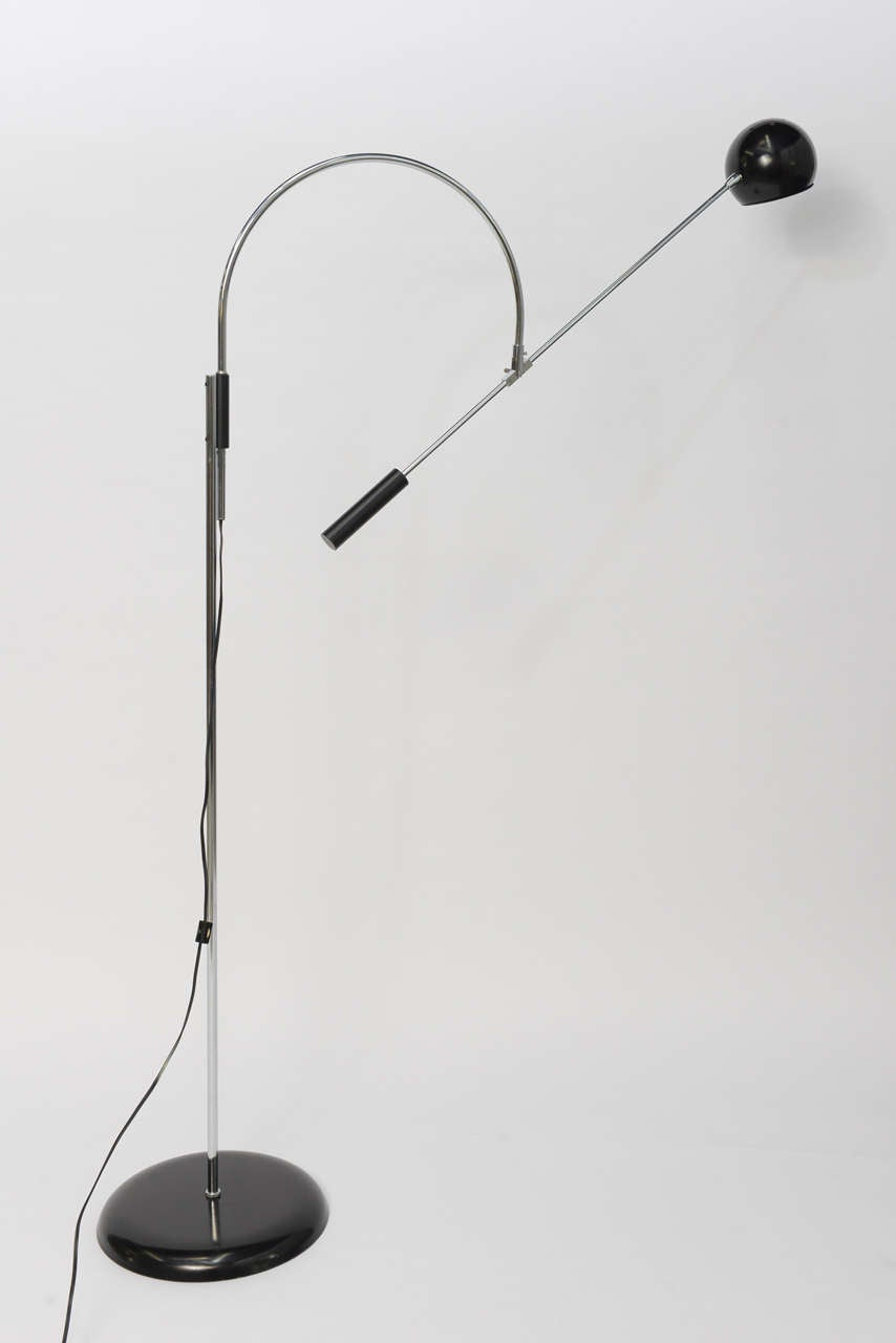SOLD  Probably his most iconic lamp, Robert Sonneman's Orbiter floor lamp, here in original black and chrome.  With a wide range of movement and great reach, the perfect , modern elegant floor lamp. In excellent vintage condition, no issues.  Takes