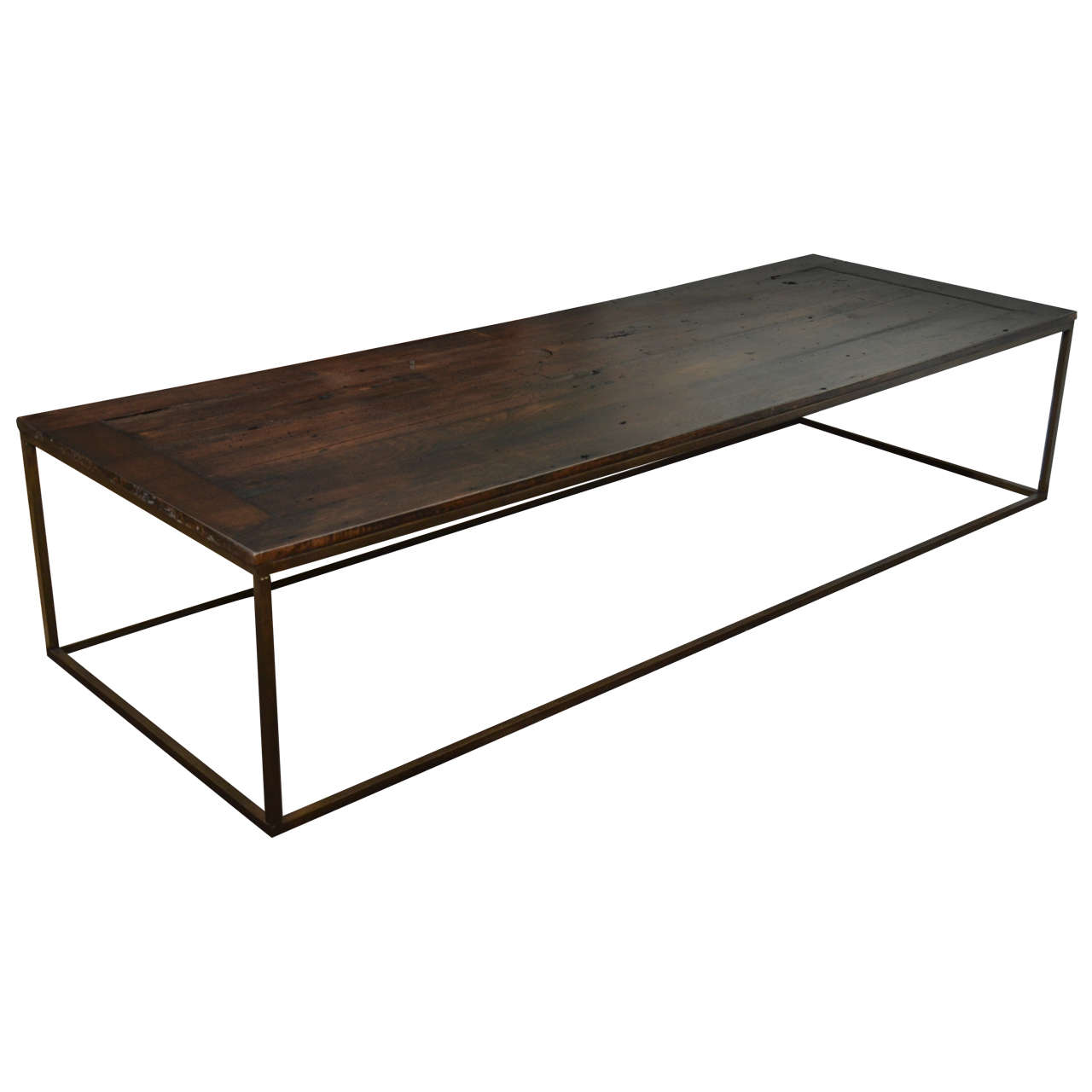 Long chestnut and bronze coffee table at 1stdibs Bronze coffee tables