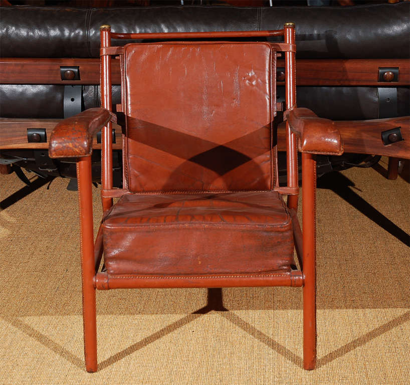 red leather & brass lounge chair