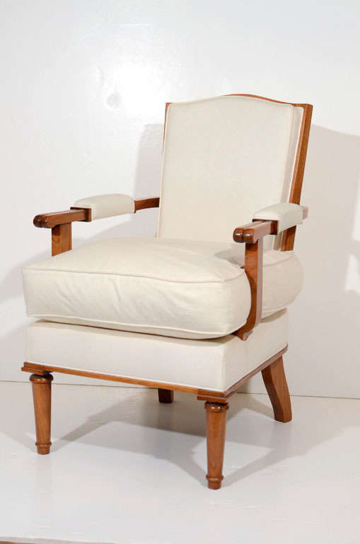 Single walnut armchair by Jules Leleu  An identical chair was shown at the Leleu exhibition, Chefs d'oeuvre de l'Afrique noire, in Leleu's showroom on the Avenue Franklin-Roosevelt, Paris (1952)  Bibliography: Jutheau, Viviane. Jules et André Leleu.