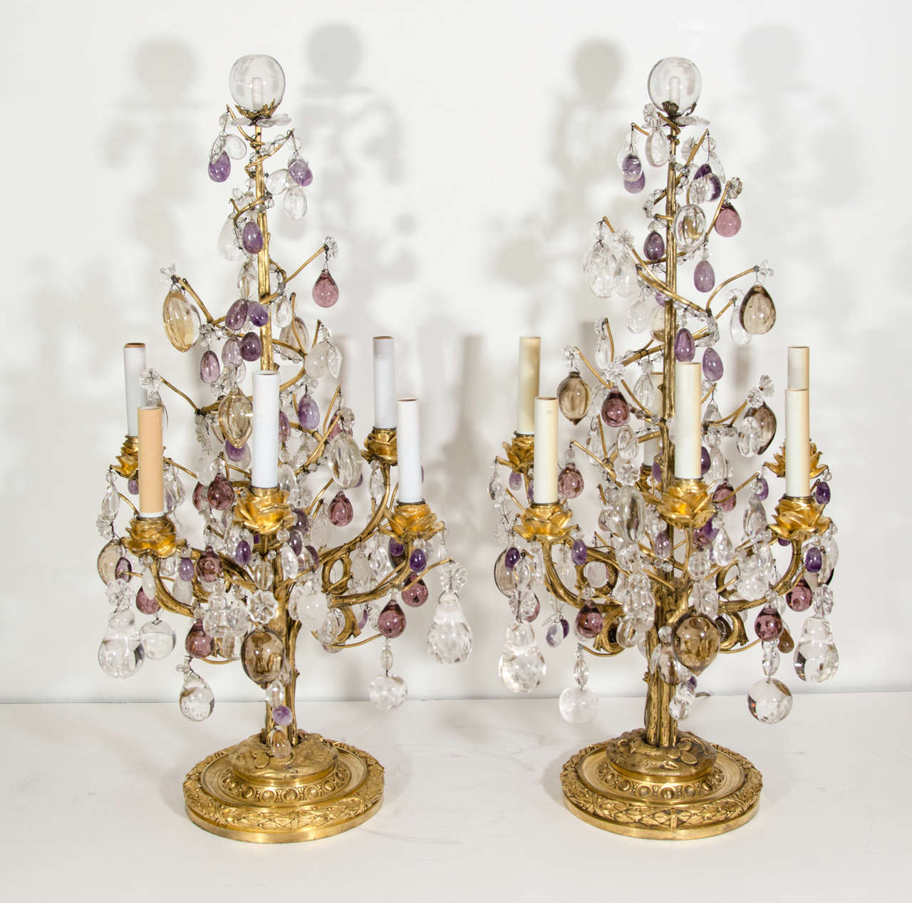 A Pair of Exquisite & Rare Antique French Louis XVI Style Gilt Bronze, Cut Rock Crystal, Amethyst Rock Crystal & Amber Glass multi light Candelabra Table Lamps embellished with gilt bronze floral arms & further adorned with rock crystal fruits and