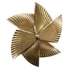 A Curtis Jere Brass Pinwheel Wall Sculpture