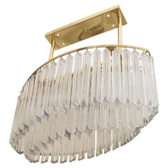 An Oval Chandelier in Brass and Glass Prisms by Venini
