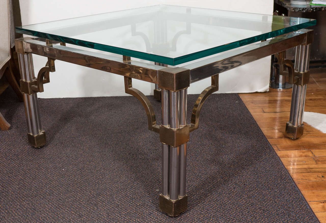 A vintage coffee table produced circa 1980s with raised glass top on chrome frame