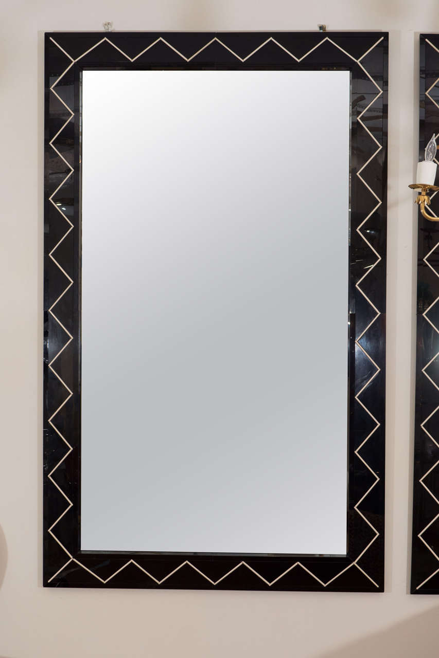 Large rectangular mirror with black glass surround featuring a zig zag design.
