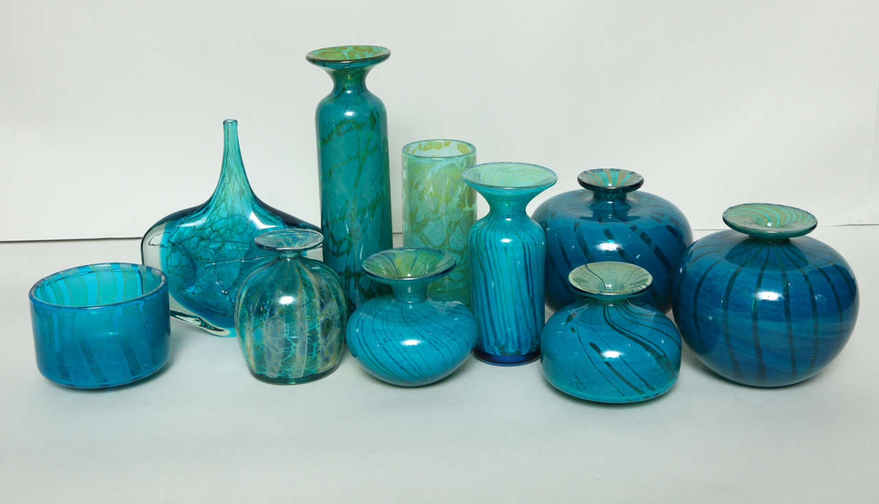 Assortment of blue and green Mdina glass vases, made in Malta in the 1960s and 70s under the direction of founder Michael Harris, an English artist who established the Mdina glassworks.  Among this collection are two