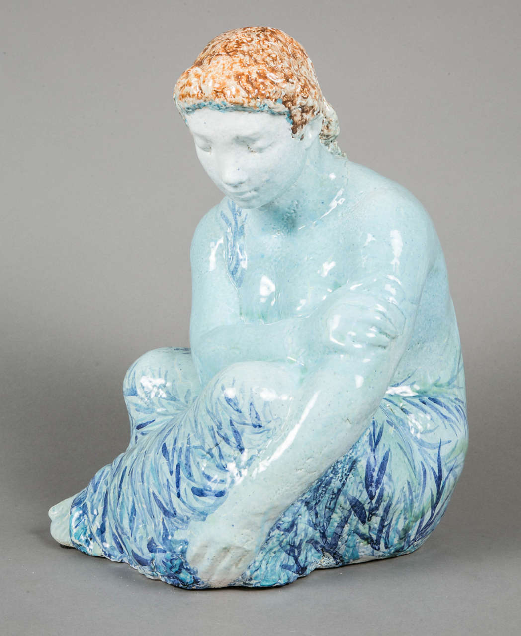Important blue enameled ceramic sculpted sitting woman by Odette Lepeltier (1914-2006).