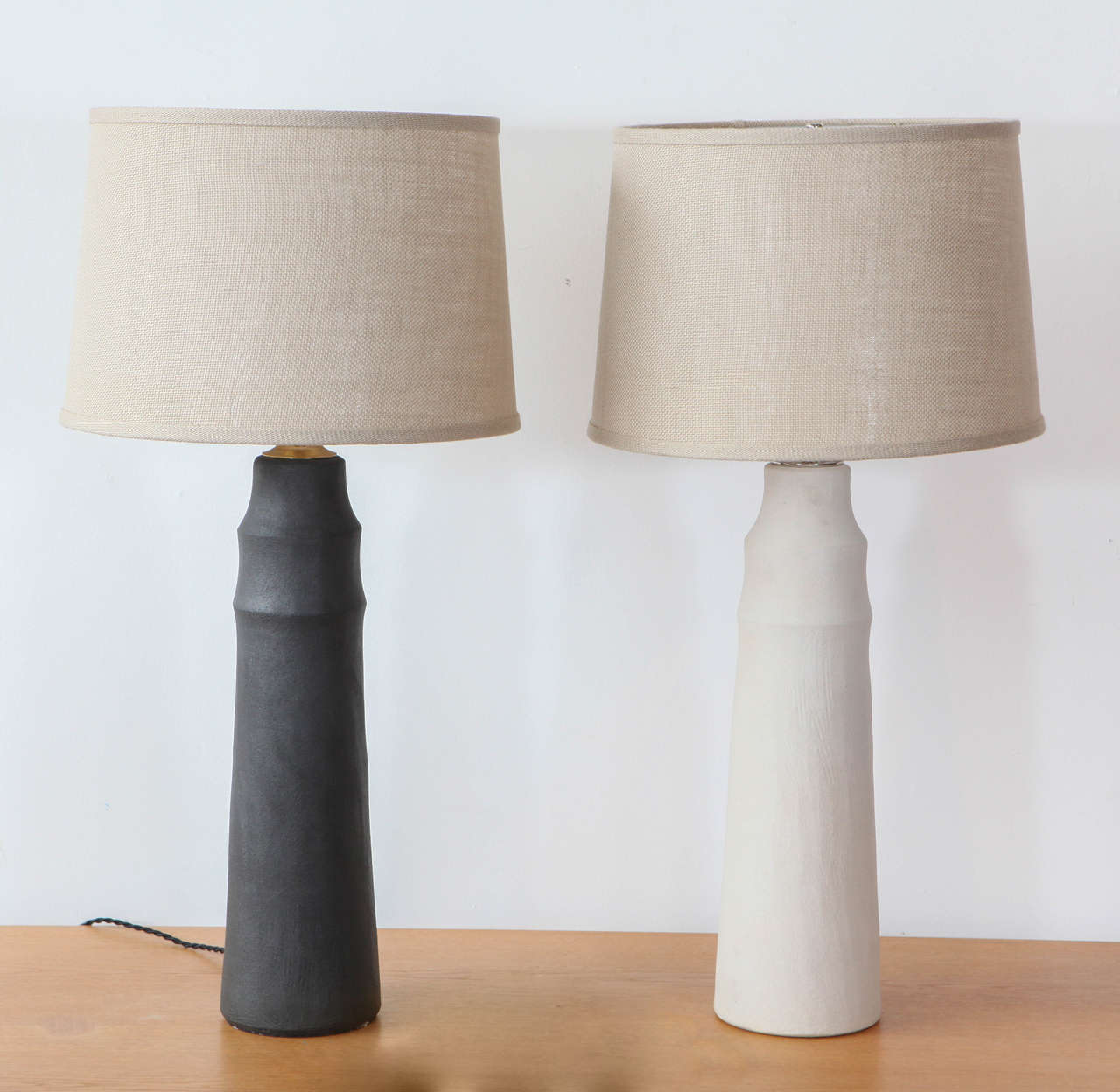Ceramic table lamps by Los Angeles based ceramicist, Mirena Kim. Six week lead time if none available in stock. Available in Black, Ecru, and Ice Plant. Shades sold separately. Dimensions vary slightly.