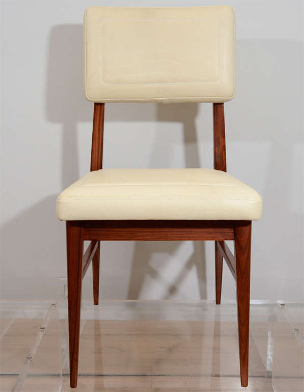 Beautifully executed dining chairs by Raphael Raffel. Topstitched leather seat and back. Seat H 18