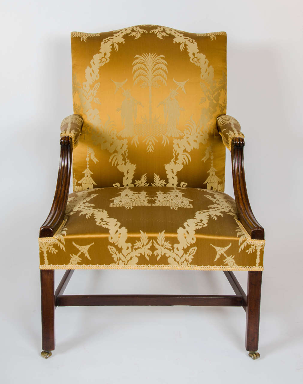 A good mahogany open armchair covered in a golden chinoiserie silk fabric.