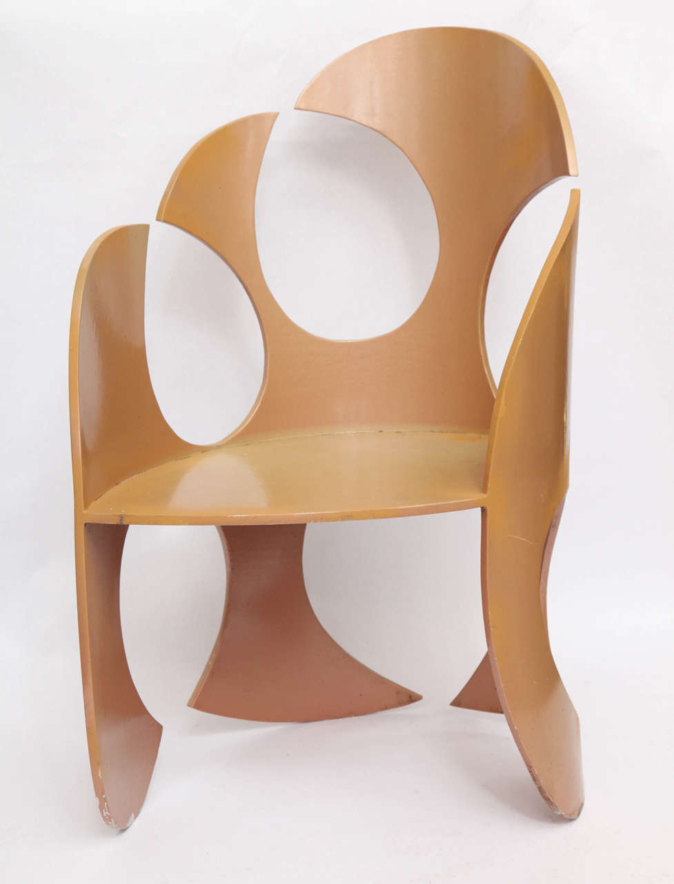 A 1980s sculptural chair crafted of painted metal.